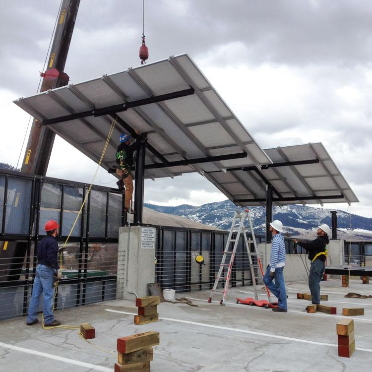 jordan solar installing a pole mounted pv panel using a crane